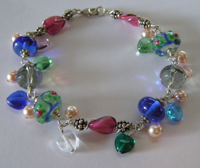 "Lampword Bead and Sterling ""Charm"" Bracelet"